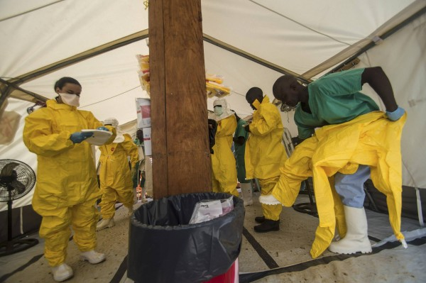 Medical staff working with Medecins sans Frontieres (MSF) put on their protective gear before entering an isolation area at the MSF Ebola treatment center in Kailahun July 20, 2014.