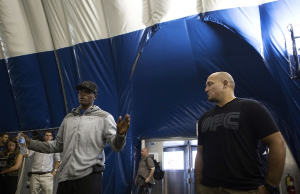 Ovince Saint Preux (left) and Shawn Jordan speak to University of Maine football players during a meet-and-greet at the campus in Orono Thursday.