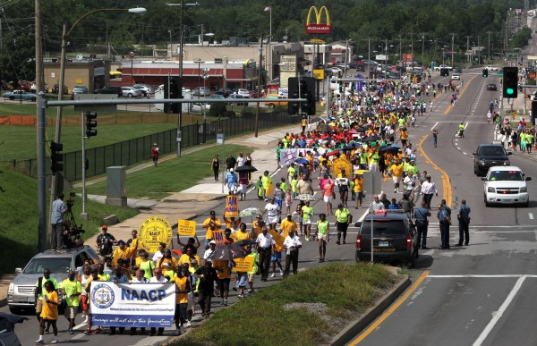 Members of the St. Louis chapters of the NAACP and the National Urban League march on Saturday on West Florissant Avenue in Ferguson, Missouri.