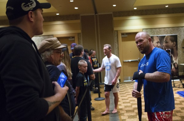 Maine native Tim Boetsch (right) interacts with fans during open workouts at Hollywood Casino in Bangor Thursday in preparation for UFC Fight Night.
