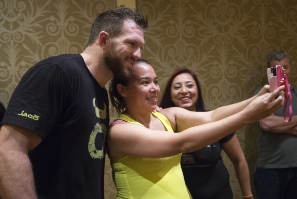 Ryan Bader (left) poses for a photo with Anjeleen Denny (center) and Mandy Denny following an open workouts at Hollywood Casino in Bangor Thursday in preparation for UFC Fight Night.