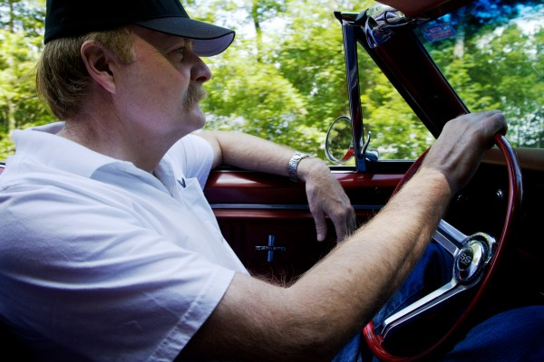 Doug Ellis drives his convertible 1967 Chevy Camaro in Freeport on Sunday.