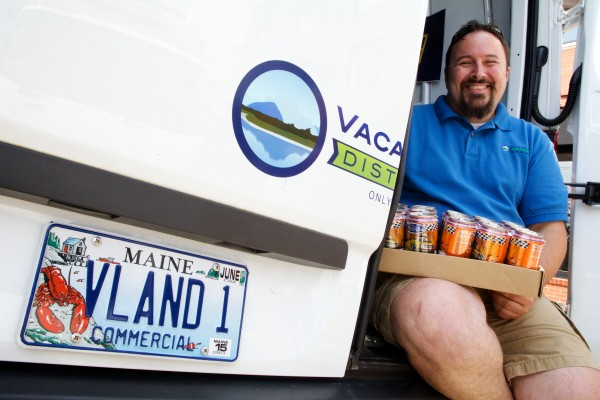 Jim O'Brien of Vacationland Distributors sits in the rear of his delivery van on Wednesday in Portland. O'Brien's startup beer distribution business is aimed squarely at small craft brewers.