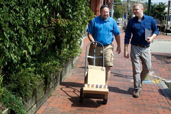 Vacationland Distrubutors' Jim O'Brien (left) is accompanied by account executive Shane Saunders as he makes a beer delivery in Portland on Wednesday. The startup company is aimed at craft brewers.