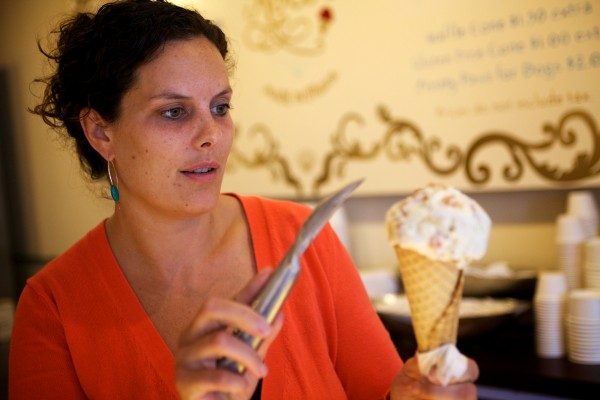 Lauren Guptill sculpts an ice cream cone made with local wheat beer, candied ginger and apricots at Rococo Artisan Ice Cream in Kennebunkport on Wednesday.