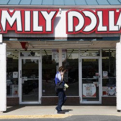 A woman walks by the Family Dollar store in Arvada, Colorado in this October 7, 2009 file photo.