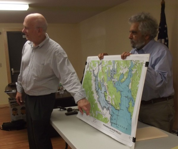Ted Verrill (left), president and CEO of Halcyon Tidal Power, and Ramez Atiya (right), a Utah physicist who is chairman and chief technology officer of the company,use a map while addressing Pembroke residents on Friday.
