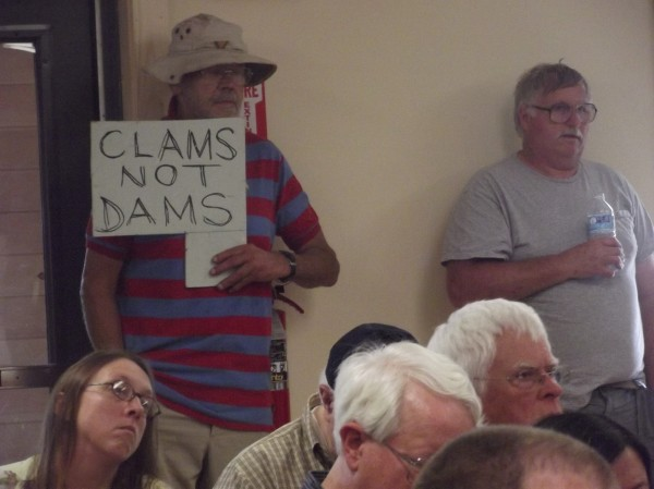 An unidentified man holds a sign that expresses the sentiment during meeting at Pembroke town office about a proposal by Halcyon Tidal Power to build a dam-like structure across the Pennamaquan River to tap tidal currents and generate electricity.
