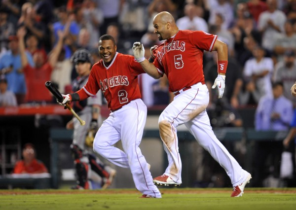 Los Angeles Angels' Albert Pujols (5) celebrates with Erick Aybar (2) after he hit a solo home run in the 19th inning against the Boston Red Sox at Angel Stadium of Anaheim, California.