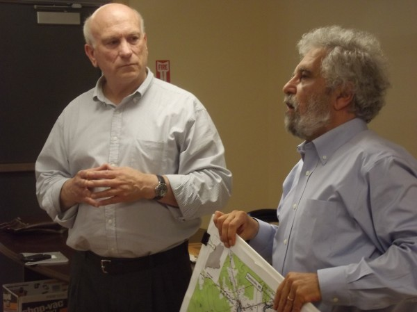 Ted Verrill (left), president and CEO of Halcyon Tidal Power, listens while Ramez Atiya (right), a Utah physicist who is chairman and chief technology officer of the company, addresses Pembroke residents.