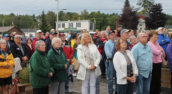 More than 200 people braved intermittent showers to celebrate the Katahdin steamship's 100th birthday on Saturday in Greenville.