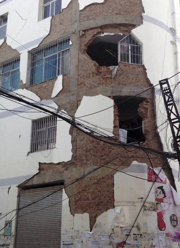 A building is damaged after an earthquake hit Ludian county, Yunnan province on Saturday, killing more than 360 people.