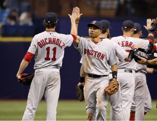 Boston Red Sox starting pitcher Clay Buchholz (11) is congratulated by right fielder Mookie Betts (50) after they beat the Tampa Bay Rays at Tropicana Field in St. Petersburg, Florida, Sunday.