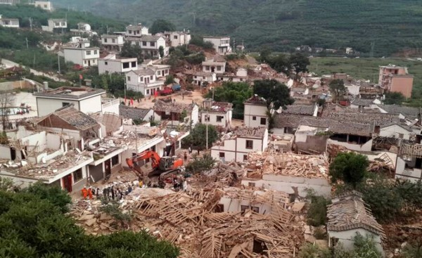 A general view shows collapsed houses after an earthquake hit Ludian county, Yunnan province on Saturday. More than 360 people died in the temblor.