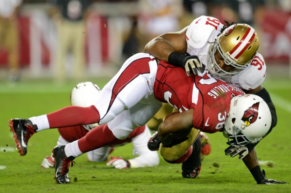 Arizona Cardinals running back LaRod Stephens-Howling (36) is tackled by San Francisco 49ers defensive end Ray McDonald (91) during a game at University of Phoenix Stadium in Glendale, Arizona, in October 2012.