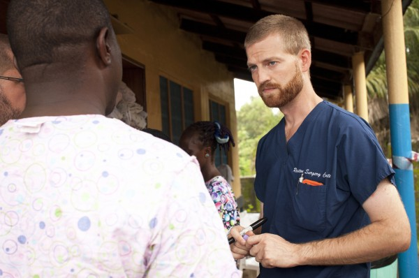 Dr. Kent Brantly, right, speaks with colleagues at the case management center on the campus of ELWA Hospital in Monrovia, Liberia in this undated handout photograph courtesy of Samaritan's Purse.