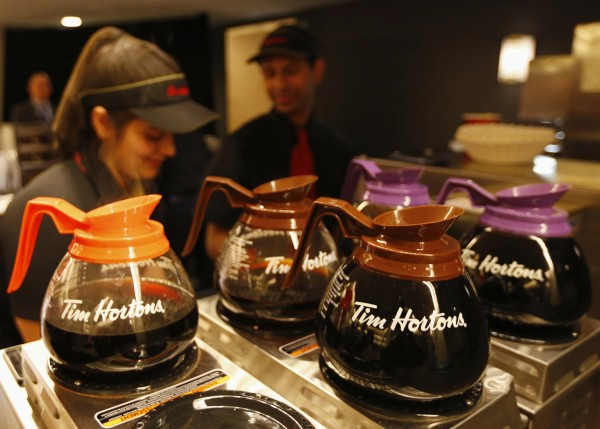 Tim Hortons employees prepare coffee before the company's annual general meeting in Toronto.