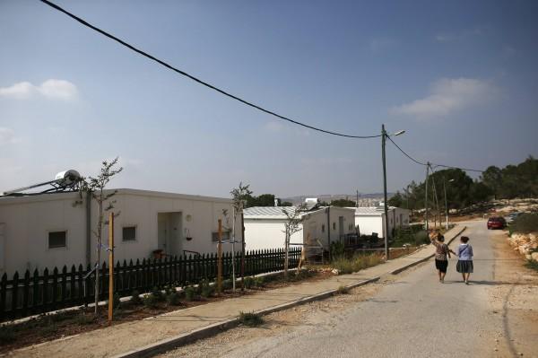 Israeli women walk in a Jewish settlement known as &quotGevaot&quot, in the Etzion settlement bloc, near Bethlehem on Aug. 31, 2014.
