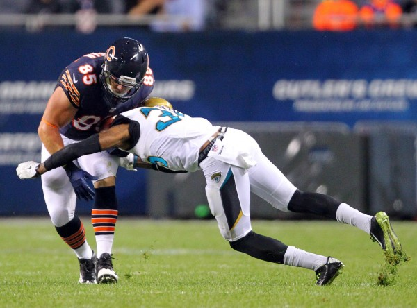 Chicago Bears tight end Matthew Mulligan (85), a Maine native, is tackled by Jacksonville Jaguars cornerback Demetrius McCray (35) during the second half of a preseason game on Aug. 14 at Soldier Field in Chicago.