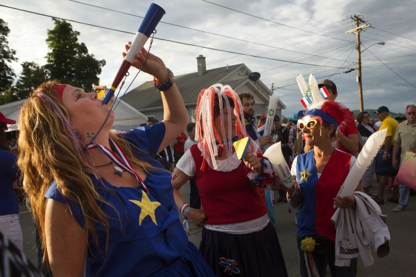 Lots of noise is made during Tintamarre on Friday on Main Street in Madawaska. About 12,000 people came out to celebrate the 2014 World Acadian Congress.