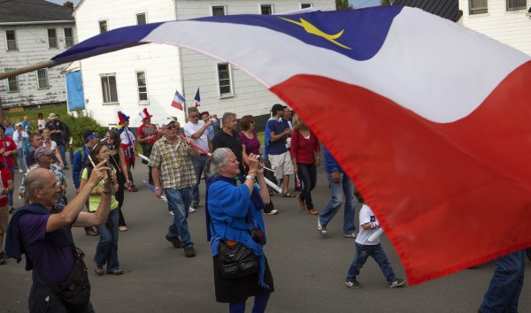 Droves of people walk and make noise during Tintamarre on Friday on Main Street in Madawaska.