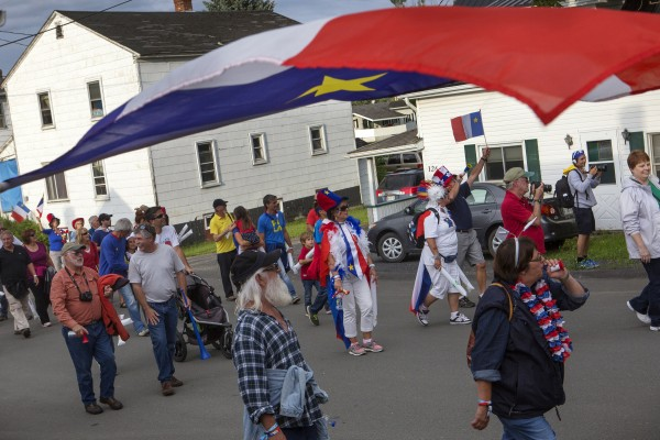 A crowd marches in the parade during Tintamarre on Friday on Main Street in Madawaska.