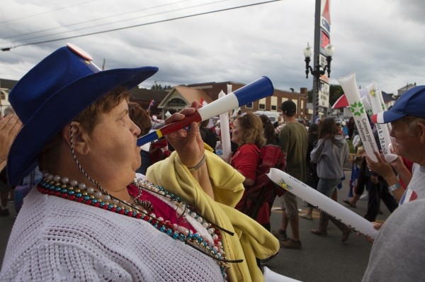 Jackie Beaulieu of St. Agatha blows her vuvuzela during Tintamarre on Friday on Main Street in Madawaska.