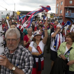 A packed parade marches during Tintamarre on Friday on Main Street in Madawaska.
