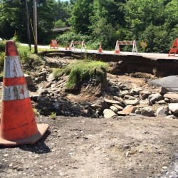 Torrential downpour washes out bridge in Freeport, strands two families