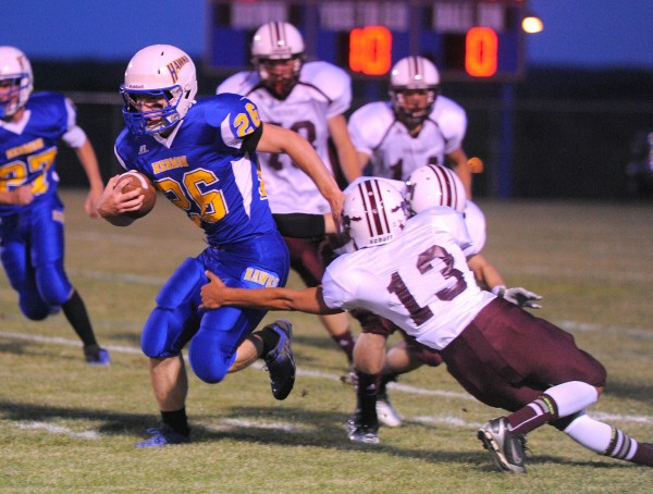 Hermon High School's David Shepardson (left) breaks a tackle by Foxcroft Academy's Chris Storer during a game in Hermon in this September 2013 file photo.
