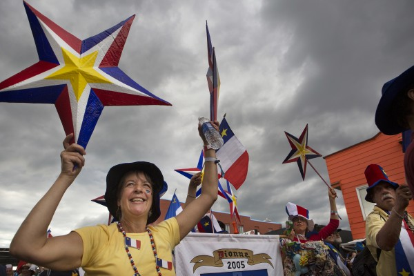 People show off their Acadian pride during the Tintamarre parade on Friday in Madawaska.