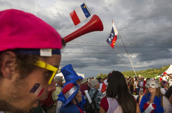 People donning Acadian garb gather outside the Multi Purpose Center during Tintamarre on Friday in Madawaska.
