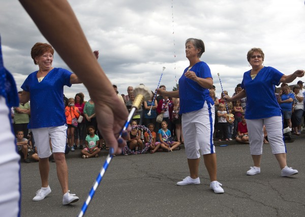 Solid Gold Twirlers perform their routine during Tintamarre on Friday on Main Street in Madawaska.