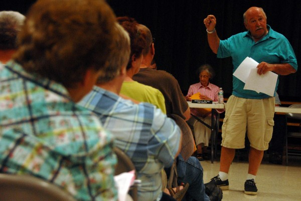 Developer and former Lincoln Town Councilor Sterling Osgood discusses his proposal to build a new town office on Fleming Street during a town meeting Monday, Aug. 25, 2014.