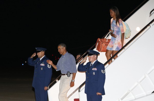 President Barack Obama and daughter Malia step out from Air Force One upon their arrival at Joint Base Andrews in Washington in this August 2014 file photo.