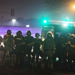 One shot, seven arrested in clashes after curfew in Ferguson, Missouri