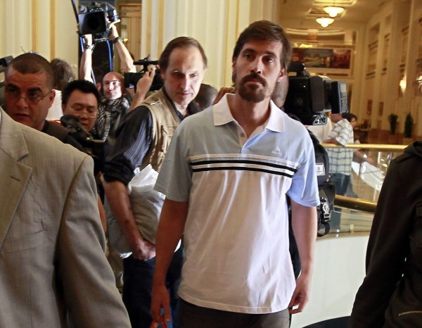 U.S. journalist James Foley (right) arrives at Rixos hotel in Tripoli, after being released by the Libyan government, in this May 2011 file photo.