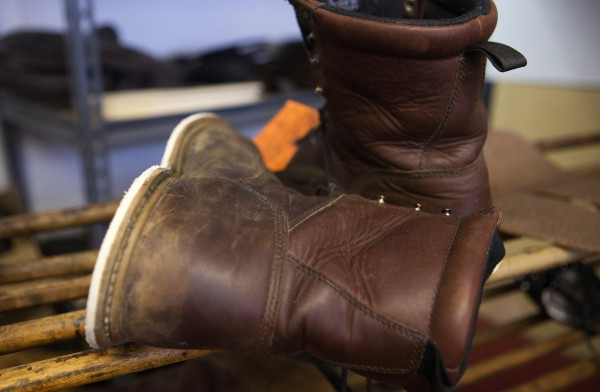 A pair of boots wait to have a new sole added on at Yankee Cobbler in Bangor on Thursday. Owner Jonathan Lambert has been a cobbler for around 10 years.