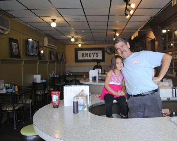 Dennis Fogg, owner of Uncle Andy's Diner in South Portland, with his 5-year-old granddaughter, Brooklyn Head, last week. Fogg will host a viewing party and comedy show at The Gold Room in Portland for the debut of the diner's episode of &quotRestaurant: Impossible&quot on Wednesday, Aug. 27.
