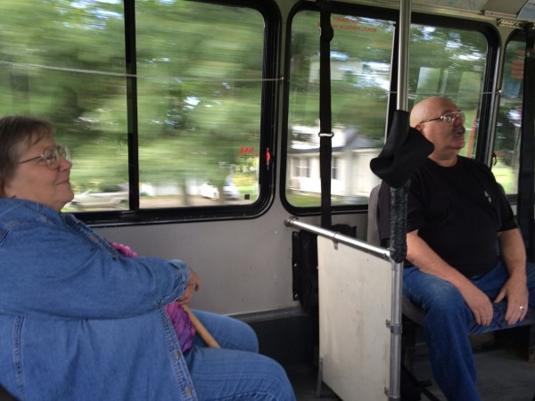 Joyce Rankin (left) who petitioned to get Saturday bus service in town several years ago, rides the bus on Saturday and listens as Hampden resident Stephen King tells stories about being mistaken for the famous Bangor author who has the same name.