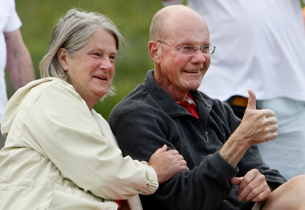 Don Winslow, right, gives a thumbs-up in support of the flash mob unfolding in front of him and his wife Dora Winslow on Tuesday, June 17, 2014 at the Bangor Waterfront.