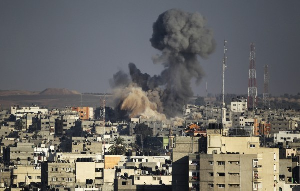 Smoke rise after an explosion in what witnesses said was an Israeli air strike in Gaza Aug. 10, 2014.