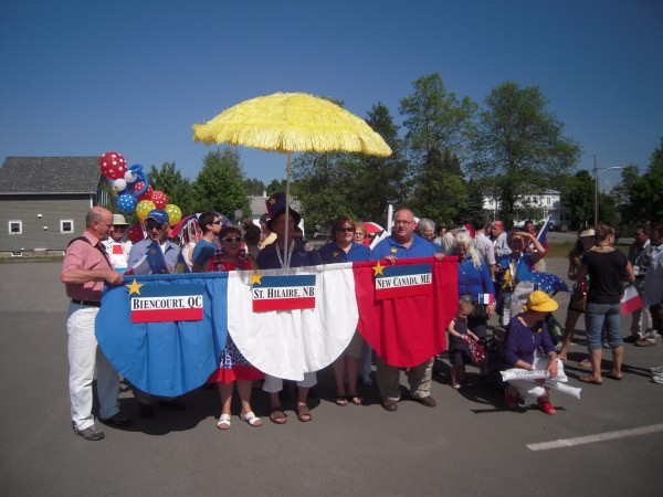 A &quottriplet&quot composed of residents from Biencourt, Quebec, St. Hilare, New Brunswick, and New Canada, Maine, assembles on Aug. 24 in Cabano, Quebec for a parade to celebrate the closing of the 2014 World Acadian Congress.