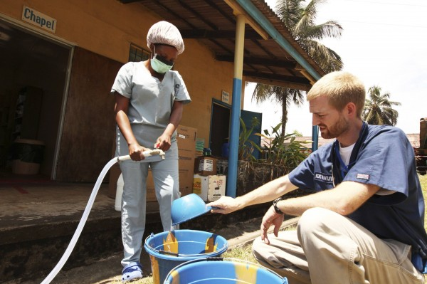 Dr. Kent Brantly (right) makes chlorine solution for disinfection at the case management center on the campus of ELWA Hospital in Monrovia, Liberia in this photograph. Brantly contracted Ebola and has been described as stable but suffering from some symptoms of the contagious disease, for which there is no known cure.