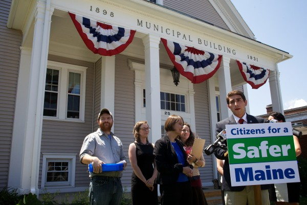 Marijuana Policy Project holds a press conference before advocates turn in 1,521 signatures seeking a legalization referendum at City Hall in South Portland on last month. The referendum will go to South Portland voters in November.