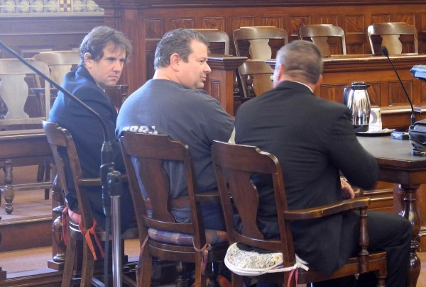 Todd Gilday (center) sits with his attorneys Jeremy Pratt (left) and Philip Cohen at the Waldo County Superior Court Wednesday. Superior Court Justice Robert Murray sentenced Gilday to 50 years for killing Lynn Day Arsenault in Belfast last year.