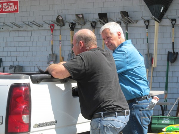 U.S. Rep. Mike Michaud, who is the Democratic nominee in the 2014 governor's race, talks with Warren Brown of East Millinocket during the town's Summerfest weekend on July 12, 2014.