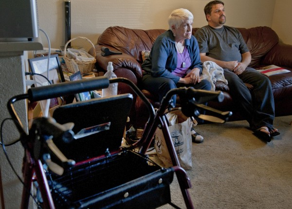 Joy Thomas, 76, left, and her son Kevin Thomas, 48, pictured Feb. 2, 2012, in Rocklin, California, were hounded by debt collectors over the past year.