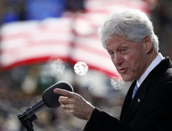 Former U.S. President Bill Clinton speaks to a crowd at a campaign event for U.S. President Barack Obama at State Capitol Square in Concord, New Hampshire, November 4, 2012.