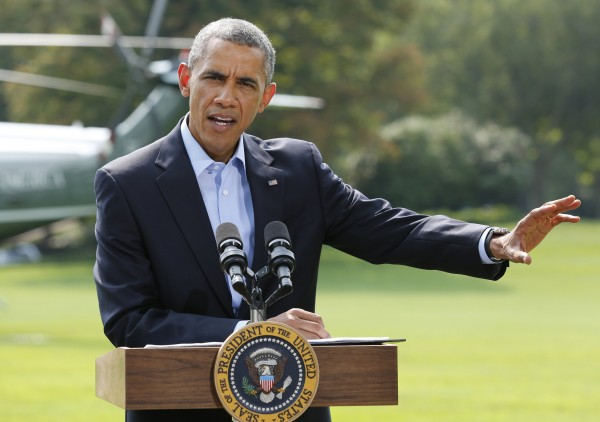 President Barack Obama speaks on the situation in Iraq on the South Lawn of the White House in Washington on August 9, 2014, before his departure for vacation in Martha's Vineyard, Massachusetts.